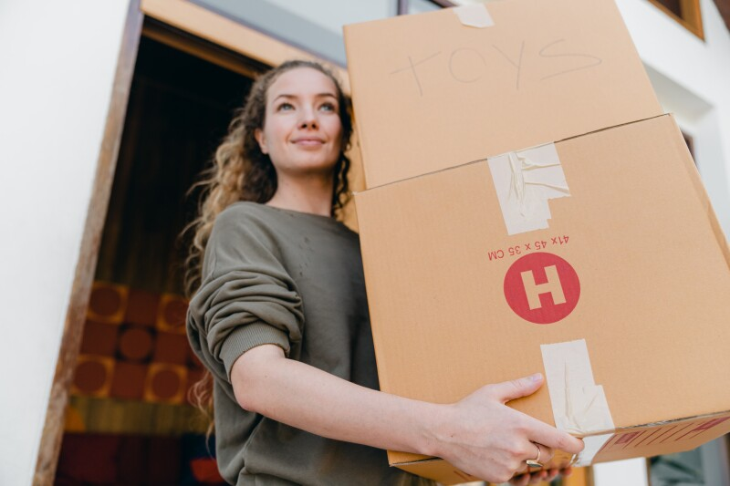 young woman with boxes while moving out of old home 4246270
